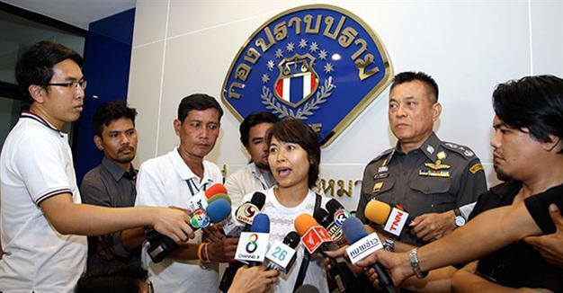 Thai police briefly detain British journalist's wife over royal