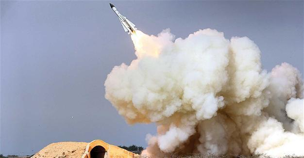 Iran vows 'roaring missiles' if threatened, defies new sanctions