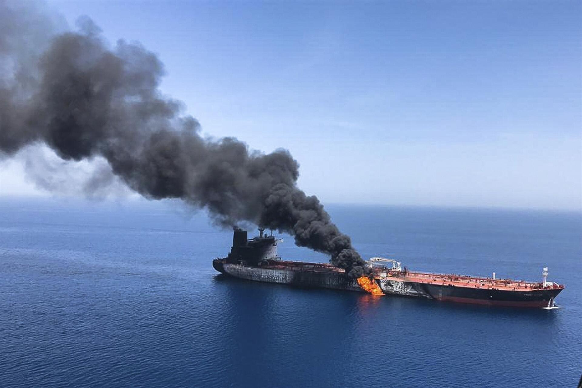 Two tankers catch fire after suspected Gulf of Oman attacks - World News