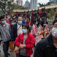 HK leader declares virus emergency halts official visits to mainland