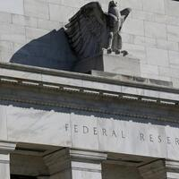 Fed takes emergency steps to slash rates and ease bank rules