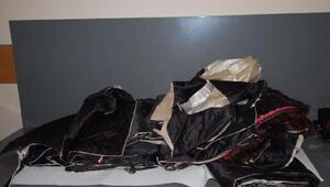 Atatürk Havalimanında masa örtüleri arasında 9 kilo 960 gram afyon sakızı yakalandı