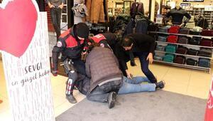 Çalışanlarıyla tartıştığı mağazayı pompalı tüfekle bastı