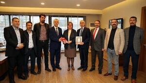 DİSK'ten Pekdaş'a 'hayır'lı ziyaret