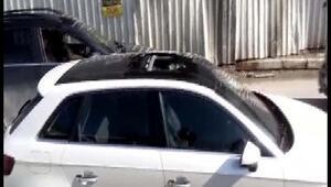 Seyir halindeki bir otomobilin üstüne inşaattan taş düştü
