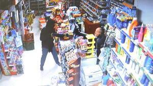 Silahlı soyguncuyu veresiye defteriyle kovaladı