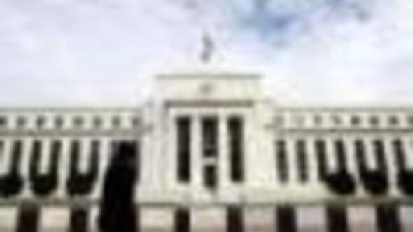 Fed lowers growth forecast, raises inflation