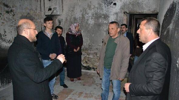 Başkan Özcandan, evi yanan aileye yardım sözü