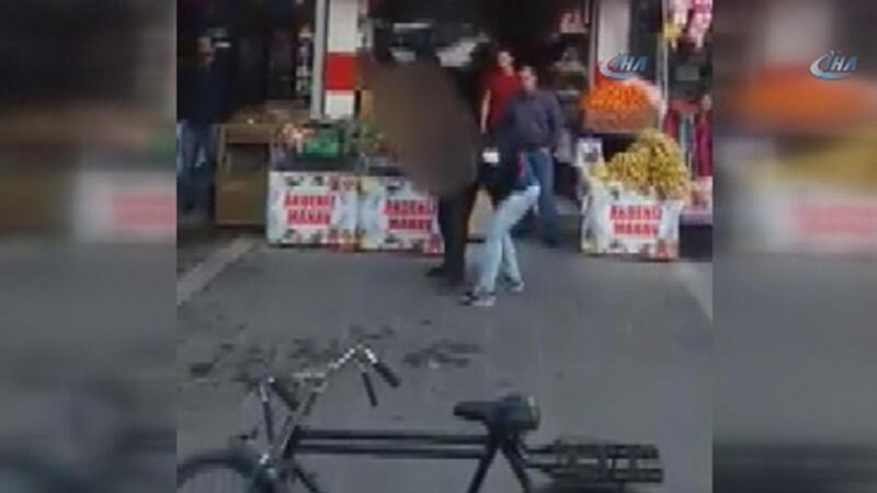 Kadın sokak ortasında dayak yedi vatandaş izledi