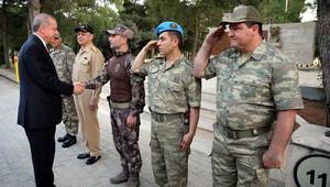 Cumhurbaşkanı Erdoğan'ın yanındaki rütbesiz askerin kim olduğu belli oldu