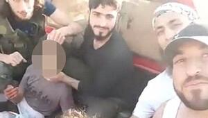 AFP: Suriye'de muhalifler küçük çocuğun kafasını kesti