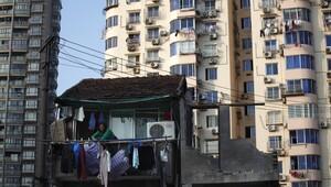 Çin'in inatçı ev sahipleri evlerini yıktırmadı