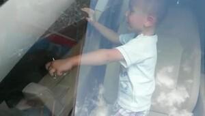Otomobilde kilitli kalan çocuk, cam kırılarak kurtarıldı