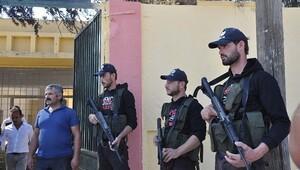 ÖSO üyelerine Türk polisi şapkası