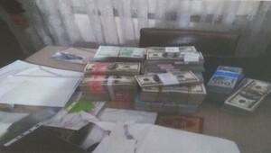 Memurun çantasından 1 milyon dolar çıktı