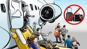 Uçaklarda acil tahliyelerde yolcular el bagajlarını alamıyacak