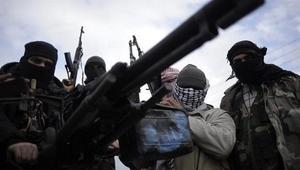 Eğit - donat komutanı cephaneyi Nusra Cephesi'ne teslim etti