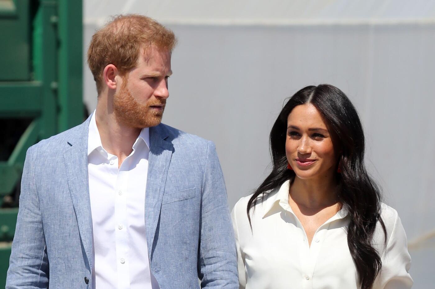 Prince Harry, Meghan Markle step back as senior royals - World News