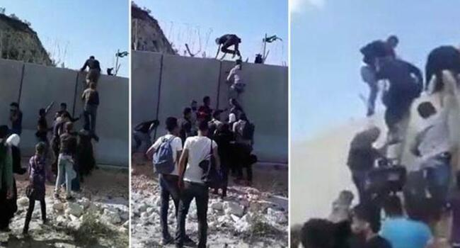 Footage shows Syrians scaling Turkish border wall with ladders