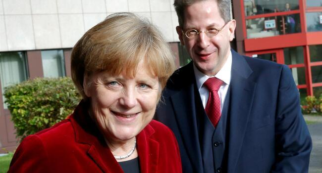 Merkel removes spy chief to defuse row over far-right