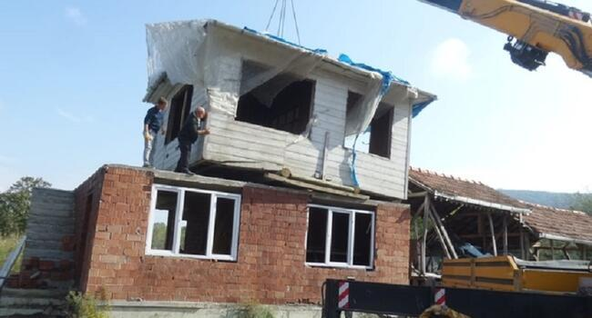 Turkish man moves father's house on top of own house
