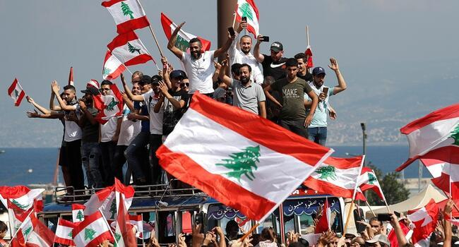 Lebanon set to cut ministers pay as protests engulf country